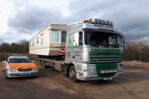 static caravan on transport lorry