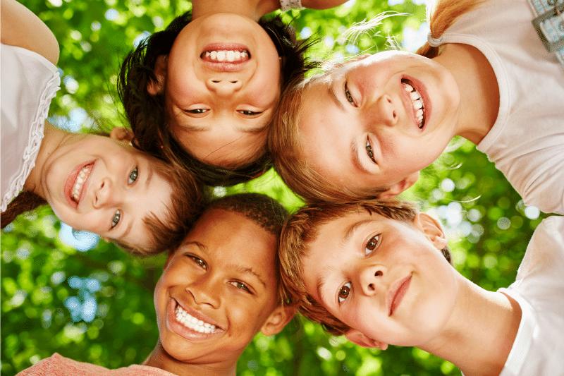smiling kids looking at camera